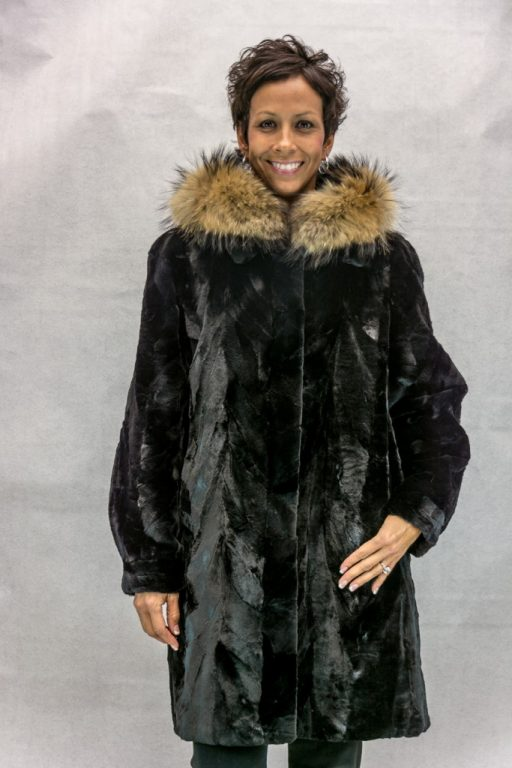 W51 black sheared mink 36 sections with a detachable hood trimmed with finnish raccoon reverses to black taffeta silk2
